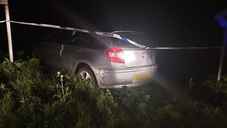 The BMW stuck in the verge in West Stow. Picture: MILDENHALL POLICE