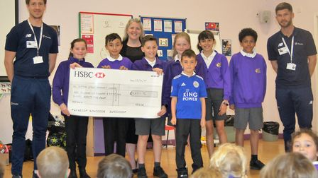 Headteacher Melanie Moore with pupils and Premier Education coaches Callum Kearns (left) and Gareth