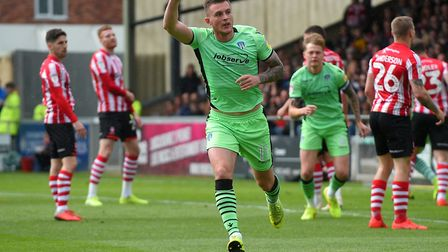 Brennan Dickenson celebrates putting the U's 1-0 up at Lincoln. Picture: PAGEPIX
