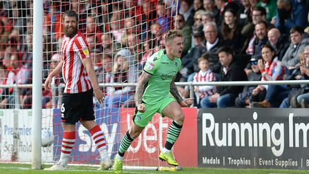 Sammie Szmodics celebrates scoring the first of his two first-half goals, in a final day 3-0 win at