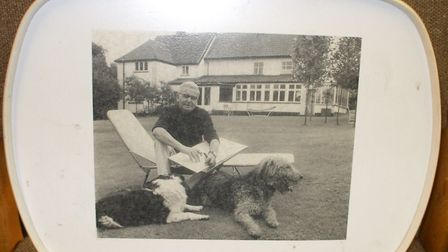 An intriguing tray bearing an interesting picture of Giles and his dogs, presumably in his garden at
