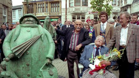 In September, 1993, a statue celebrating the life and work of cartoonist Carl Giles (seated) was unv