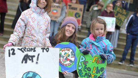 Elsie, Annie and Betsy Neil with their signs at a climate change protest in Ipswich. Picture: SARAH