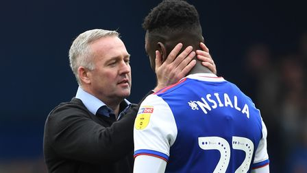 Ipswich Town manager Paul Lambert (left) and Toto Nsiala at the end of Town's 3-2 win over Leeds. Pi