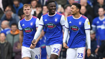 Ipswich Town's Andre Dozzell (right) celebrates scoring his team's second goal with Toto Nsiala and