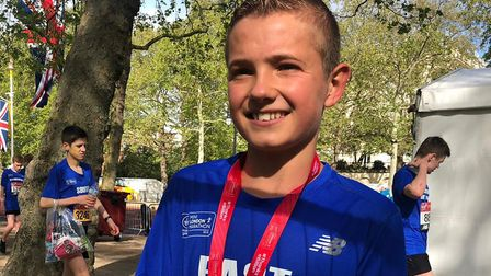 Lewis Sullivan, of Saint Edmund Pacers, pictured after finishing 11th in the under-15 boys' race at