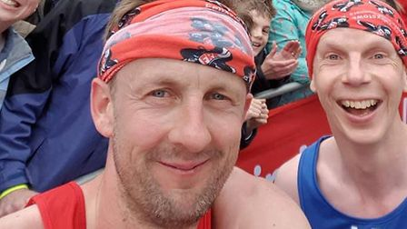 The Felixstowe Road Runners duo of Dan Clark, left and Alastair Read, who stopped for a selfie on To
