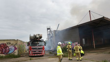 Fire crews attend the scene of a huge fire at the Fisons factory site in Paper Mill Lane Picture: S