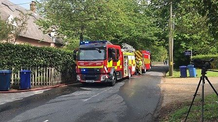 Firefighters are at the scene of a suspected gas explosion in Lidgate, near Newmarket in Suffolk Pic