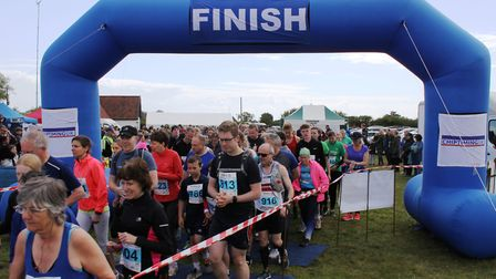 Runners and walkers at the end of the Heritage Coast Marathon. Picture: OWEN LOWER