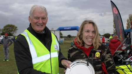 Heritage Coast Marathon winner Sarah Fitch from Felixstowe collects her trophy. Picture OWEN LOWER