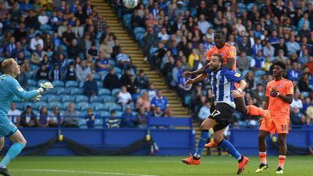 Toto Nsiala heading Ipswich Town level at Sheffield Wednesday. Photo: Pagepix