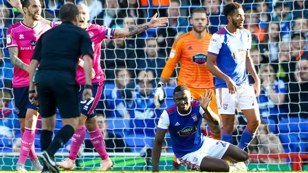 Toto Nsiala concedes a penalty in the 2-0 home loss to QPR last October. Paul Hurst was sacked a gam