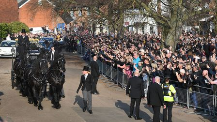 The funeral cortege of Keith Flint arriving at St Mary's Church in Bocking, Essex, as fans look on P