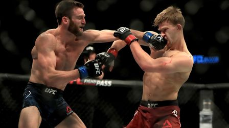Arnold Allen (right) absorbs a punch from Jordan Rinaldi during their fight at UFC London - one of t