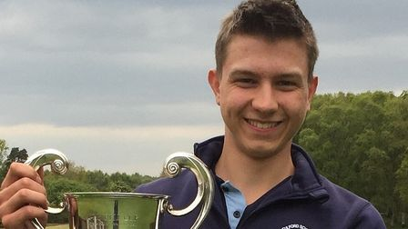 Flempton's Samuel Jensen with the Bell Cup which he won at the Thorpeness Junior Open. Photograph: C