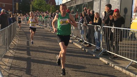 Ed Mitchell, of Colchester Harriers, striding out to a fine time of 15:39 at the Ipswich Twilight 5K