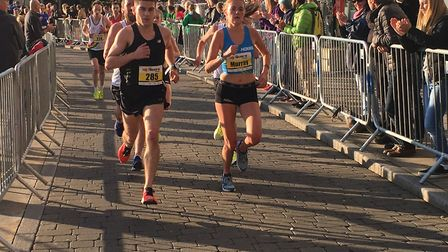 Ipswich Harriers' Conor Whiting (Ni. 285) in action alongside elite lady Rebecca Murray. Picture: CA