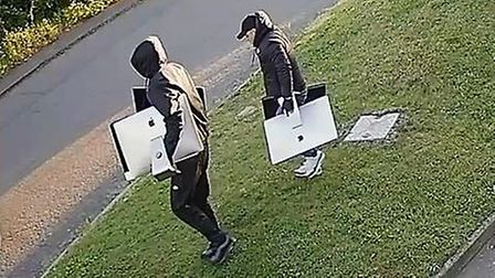 The men could be seen walking out to the front of the building carrying the computers which were wor