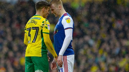 Flynn Downes faces off with Max Aarons as tempers flare at Carrow Road. Photo: Pagepix