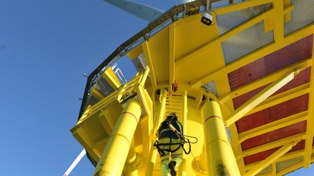 Wind turbine technicians climbing. There are opportunities for young people to train as engineers fo