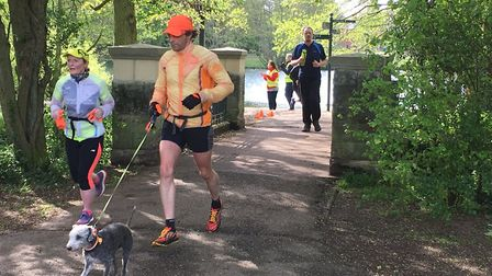 Runners, and dogs, cross the small bridge during the three laps of the Lincoln parkrun. Picture: CAR