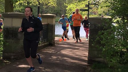 Runners, with the lake in the background, approach the finish to last Saturday's Lincoln parkrun. Pi