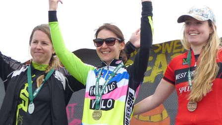 Ipswich winner Katie Scotter flanked by Alison Gunnell (L) and Alex Earl on the podium at the Debden