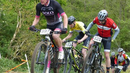 Colchester rider Mark Wellsted calmly climbs on a tiny gear at the Debden MTB races. Picture: FERGUS