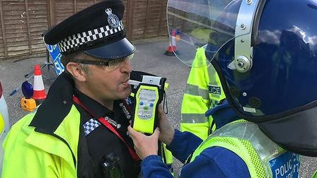 A Tattingstone Church of England Primary School pupil breathalysing an officer from Ipswich West Pol
