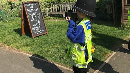 A pupil from Tattingstone Primary School testing out a speed laser on passing cars. Picture: IPSWICH