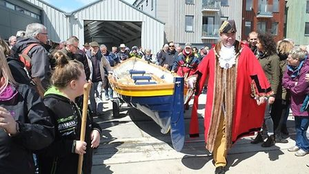 The boat, made by student volunteers from Suffolk's Just 42, was christened the Hoo Kanoo Picture: M