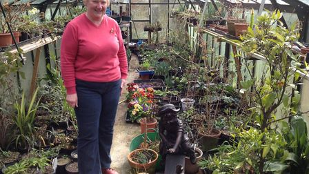 Jane Bastow in her vast greenhouse - 11 feet wide and three feet long - in 2015 Picture: STEVEN R