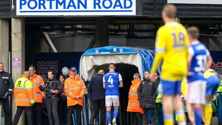 Luke Chambers heads down the tunnel after being sent off against Leeds United. Photot: Steve Waller