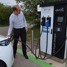 Senior environmental management officer Nathan Pittam tries out the newly installed rapid charging p