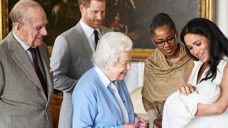 The Queen and the Duke of Edinburgh meet their latest great grandchild Archie, being held by his mot