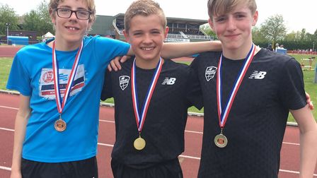 The winning trio in the under-15 boys' 1,500m, from left, Ben Peck, winner Lewis Sullivan and James