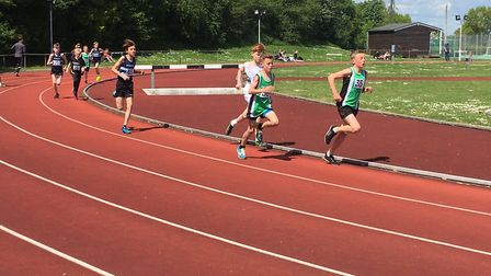 Action from combined under-13/under-15 boys' race over 1,500m, with Jacob Trangmar leading the chasi