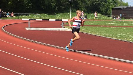 Lewis Sullivan, out on his own in the under-15 boys' 1,500. He broke the championship record