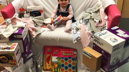 One-year-old Milah with gifts donated to the neonatal unit at West Suffolk Hospital Picture: UK POWE