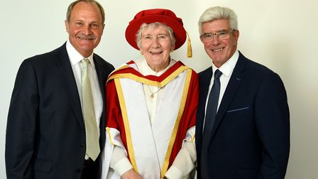 Patricia Godbold pictured with Mick Mills (left) and Bryan Hamilton before receiving her honorary do