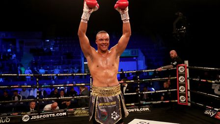 Fabio Wardley raises his arms in victory after stopping Dennis Lewandowski in Nottingham. Picture: P