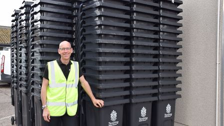 Jon Hamlet, street scene officer, with some of the new bins Picture: WILL LODGE/MATT CATTERMOLE/TDC