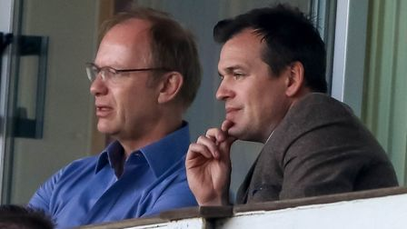 Town owner Marcus Evans (left) and general manager of football operations Lee O'Neill watch on. P