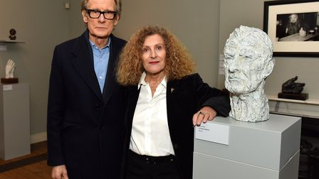 Bill Nighy with Nicole Farhi at the opening of her exhibition Heads and Hands which is currently on