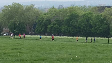 A procession of runners taking part in last Saturday's Hilly Fields parkrun, in South-East London. P