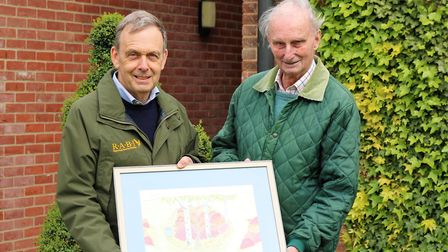 From left, Suffolk Show President Stephen Miles and John Dyter with plans for their floral exhibit