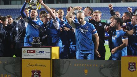 Leiston celebrate winning the Suffolk Premier Cup final on the same night Spurs were beating Ajax Pi