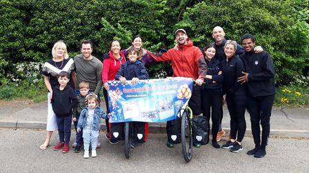 Hannah (purple jacket) and her husband Ross (red jacket) have left Suffolk bound for China Picture: