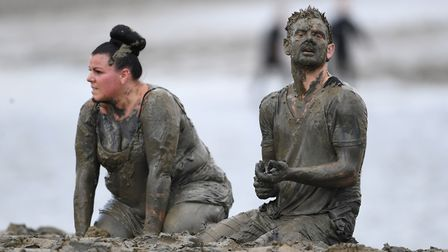Competitors take part in the annual Maldon Mud Race Picture: Joe Giddens/PA Wire